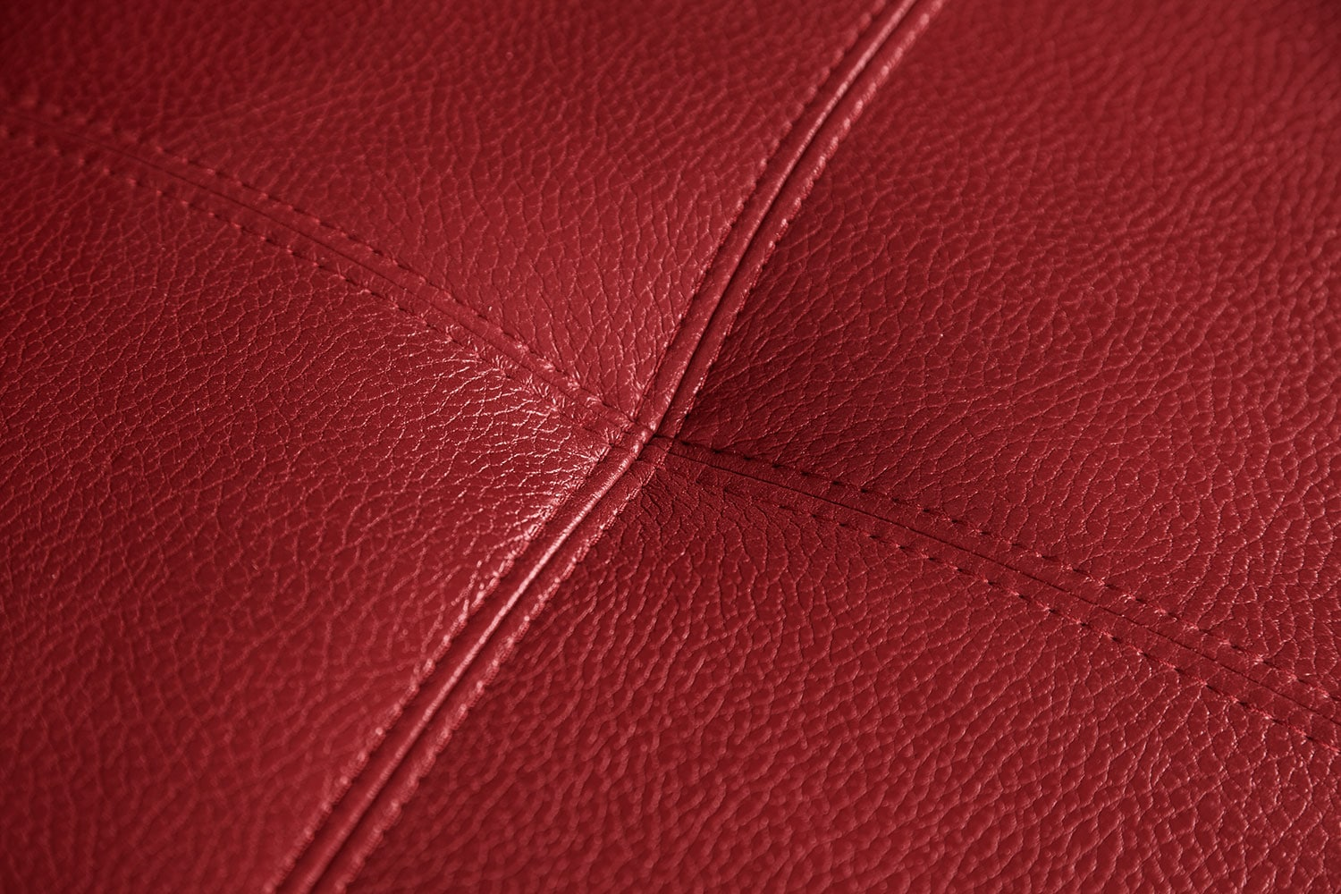 Costa leather look fabric ottoman red united furniture for Red leather fabric
